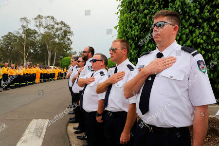 New South Wales Rural Fire Service crew watch as the casket of NSW RFS volunteer Andrew O'Dwyer arrives for his funeral service at Our Lady of Victories Catholic Church in Horsley Park, Sydney, . O'Dwyer, 36, and RFS colleague Geoffrey Keaton were killed six days before Christmas when a tree fell in the path of their truck at the still-burning Green Wattle Creek fire, causing it to roll
