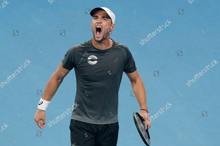 Dimitar Kuzmanov of Bulgaria reacts to winning a point against Steve Darcis of Belgium during their ATP Cup tennis match in Sydney