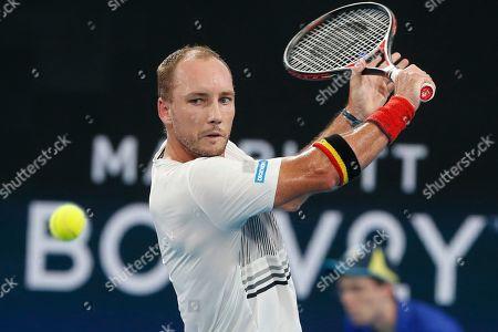 Steve Darcis of Belgium plays a shot against Dimitar Kuzmanov of Bulgaria during their ATP Cup tennis match in Sydney