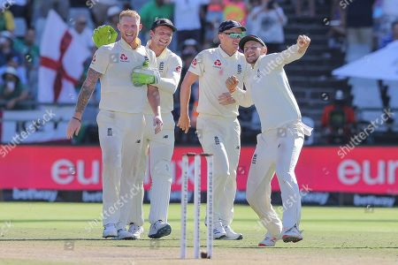 England's Ben Stokes, left, Jos Buttler, second left, and Joe Root, right, celebrate after beating South Africa in the second cricket test between South Africa and England at the Newlands Cricket Stadium in Cape Town, South Africa