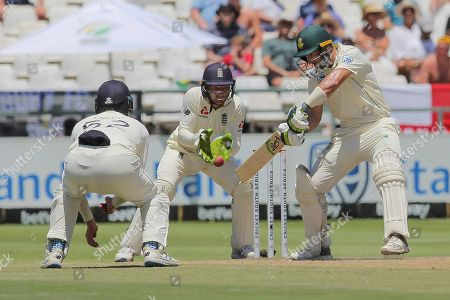 South Africa's batsman Pieter Mlan plays a shot while England's wicketkeeper Jos Buttler watches on during day five of the second cricket test between South Africa and England at the Newlands Cricket Stadium in Cape Town, South Africa