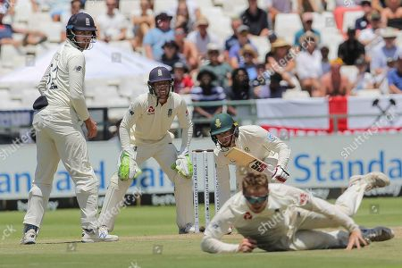 South Africa's batsman Pieter Malan along with England's wicketkeeper Jos Buttler and Dom Sibley watch at Dom bess fields the ball during day five of the second cricket test between South Africa and England at the Newlands Cricket Stadium in Cape Town, South Africa