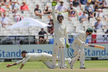 England's wicketkeeper Jos Buttler appeals the wicket of South Africa's Quinton De Kock while Ben Stokes fields the ball during day five of the second cricket test between South Africa and England at the Newlands Cricket Stadium in Cape Town, South Africa