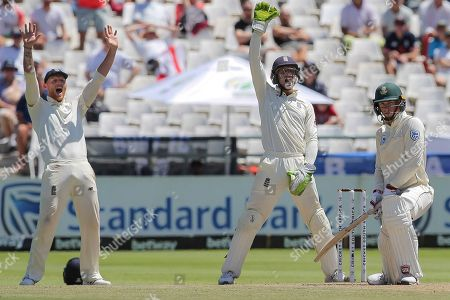 England's wicketkeeper Jos Buttler and fielder Ben Stokes appeals a wicket of South Africa's Rassie van der Dussen during day five of the second cricket test between South Africa and England at the Newlands Cricket Stadium in Cape Town, South Africa