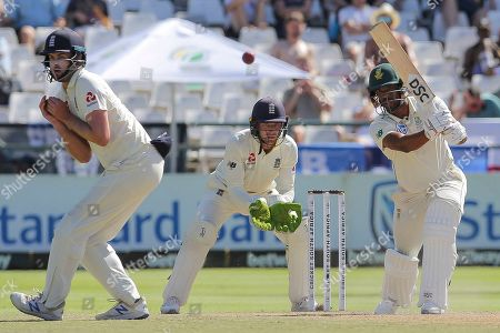 South African Vernon Philander plays a shot while England's wicketkeeper Jos Buttler, center, looks on during day five of the second cricket test between South Africa and England at the Newlands Cricket Stadium in Cape Town, South Africa
