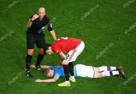 Kevin De Bruyne of Manchester City feels the pain from a knock