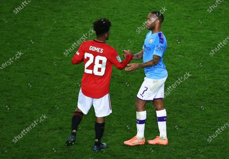 Raheem Sterling of Manchester City with Angel Gomes of Manchester United at the end of the game