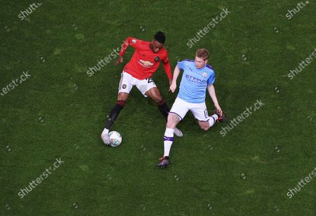 Kevin De Bruyne of Manchester City and Aaron Wan-Bissaka of Manchester United