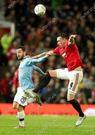 Bernardo Silva of Manchester City and Phil Jones of Manchester United