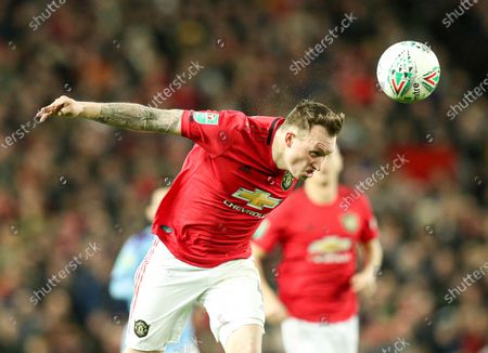 Phil Jones of Manchester United heads the ball