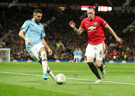 Phil Jones of Manchester United is given the run around by Riyad Mahrez of Manchester City