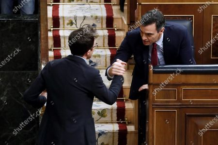 Leader of Spanish left wing Mas Pais (lit. More Country), Inigo Errejon (L), greets acting Prime Minister, Pedro Sanchez (R), after his speech at the second investiture voting at the Lower House in Madrid, Spain, 07 January 2020. The Spanish Parliament holds the second investiture voting at Parliament in which acting Prime Minister Pedro Sanchez is expected to win by a tight majority.