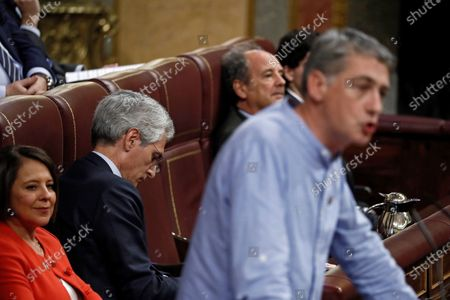 MP of the People's Party (PP) Adolfo Suarez Illana (2L) deliberately shows his back to Basque nationalist Bildu party Oskar Matute as he delivers a speech at the second investiture voting at the Lower House in Madrid, Spain, 07 January 2020. The Spanish Parliament holds the second investiture voting at Parliament in which acting Prime Minister Pedro Sanchez is expected to win by a tight majority.