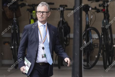 Stock Image of Conservative MP Nigel Evans walks in The Houses of Parliament.