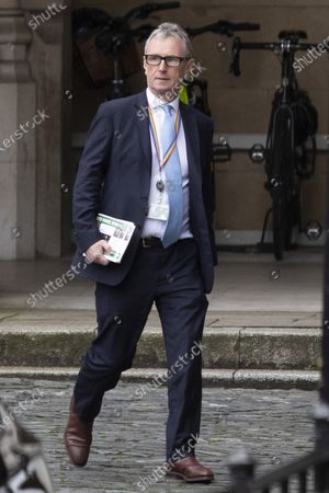 Conservative MP Nigel Evans walks in The Houses of Parliament.
