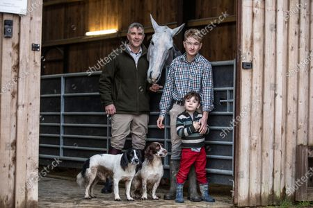 Ivan Massow, master of the Southdown and Eridge Hunt, photographed with his partner Ed and sone Theo at Halisham