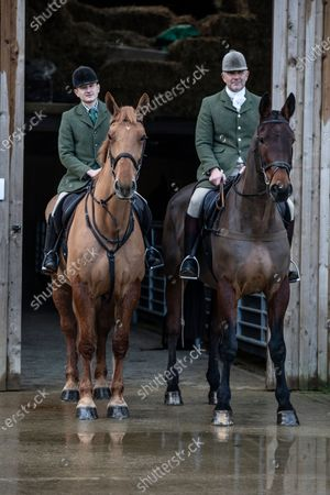 Stock Image of Ivan Massow, master of the Southdown and Eridge Hunt, photographed with his partner Ed and sone Theo at Halisham