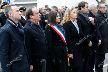 French former president Francois Hollande (2-L),, mayor of Paris Anne Hidalgo (C), French Justice Minister Nicole Belloubet (4thL) and French Interior Minister Christophe Castaner (3rdR) stand outside Charlie Hebdo's former offices 07 January 2020 in Paris, France, during a ceremony marking the fifth anniversary of the jihadist attack of the satirical magazine that killed 12 people. The attack on the weekly   with its long history of mocking Islam and other religions was the first in a series of assaults that have claimed more than 250 lives since 07 January 2015, mostly at the hands of young French-born jihadists.