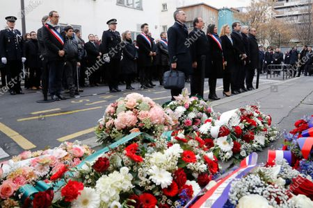 French former president Francois Hollande (2-L),, mayor of Paris Anne Hidalgo (C), French Justice Minister Nicole Belloubet (4thL), French Interior Minister Christophe Castaner (3rdR), French Culture Minister Franck Riester (2ndR) and French Junior Interior Minister Laurent Nunez pay their respect outside Charlie Hebdo's former offices 07 January 2020 in Paris, France, during a ceremony marking the fifth anniversary of the jihadist attack of the satirical magazine that killed 12 people. The attack on the weekly   with its long history of mocking Islam and other religions was the first in a series of assaults that have claimed more than 250 lives since 07 January 2015, mostly at the hands of young French-born jihadists.