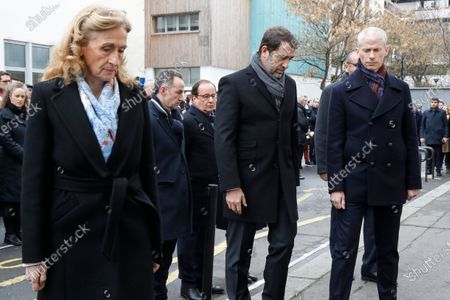 (LtoR) French Justice Minister Nicole Belloubet, French Interior Minister Christophe Castaner and French Culture Minister Franck Riester stand outside Charlie Hebdo's former offices 07 January 2020 in Paris, France, during a ceremony marking the fifth anniversary of the jihadist attack of the satirical magazine that killed 12 people. The attack on the weekly   with its long history of mocking Islam and other religions was the first in a series of assaults that have claimed more than 250 lives since 07 January 2015, mostly at the hands of young French-born jihadists.