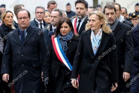 French former president Francois Hollande (L), mayor of Paris Anne Hidalgo (C) and French Justice Minister Nicole Belloubet (R), attend a ceremony marking the fifth anniversary of the jihadist attack of the satirical magazine that killed 12 people, outside Charlie Hebdo's former offices 07 January 2020 in Paris. The attack on the weekly   with its long history of mocking Islam and other religions was the first in a series of assaults that have claimed more than 250 lives since 07 January 2015, mostly at the hands of young French-born jihadists.