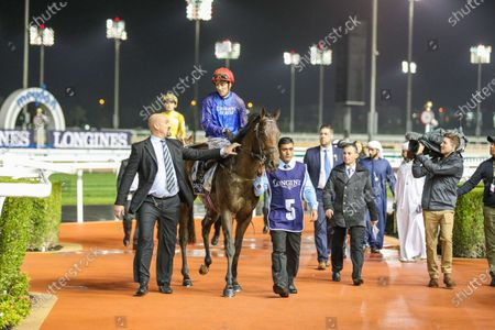 PLATINUM STAR (IRE) ridden by Christophe Soumillion wins the 6F Conditions the Dubai Trophy Presented by Longines Record Collection, race 7, at Meydan Dubai World Cup Carnival.