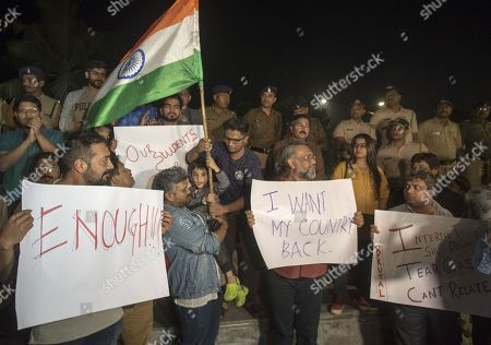 Bollywood filmmakers Anurag Kashyap, Anubhav Sinha and others hold placards as they participate in a peaceful protest against the attack on New Delhi's Jawaharlal Nehru University campus, at Carter Road, on January 6, 2020 in Mumbai, India.