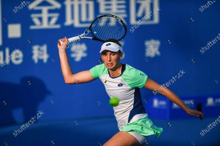 Stock Image of Elise Mertens of Belgium returns a shot during the women's singles round of 16 match