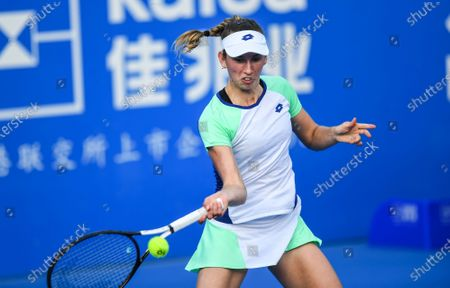 Stock Picture of Elise Mertens of Belgium returns a shot during the women's singles round of 16 match