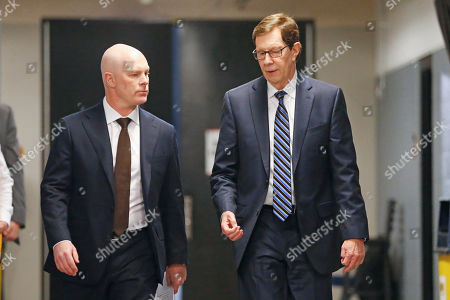 New Nashville Predators head coach John Hynes, left, walks to a news conference with Predators general manager David Poile, right,, in Nashville, Tenn. The Predators hired Hynes, the former New Jersey Devils coach, as the third coach in franchise history after firing Peter Laviolette