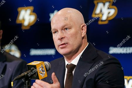 New Nashville Predators NHL hockey head coach John Hynes answers questions at a news conference, in Nashville, Tenn. The Predators hired Hynes, the former New Jersey Devils coach, as the third coach in franchise history after firing Peter Laviolette