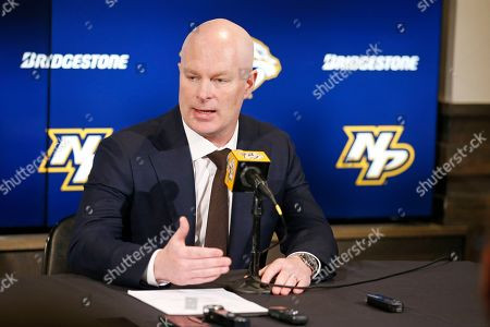 Stock Image of New Nashville Predators NHL hockey head coach John Hynes answers questions at a news conference, in Nashville, Tenn. The Predators hired Hynes, the former New Jersey Devils coach, as the third coach in franchise history after firing Peter Laviolette