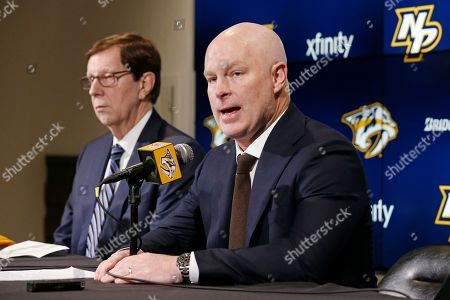 New Nashville Predators NHL hockey head coach John Hynes, right, appears at a news conference with Predators general manager David Poile, left, in Nashville, Tenn. The Predators hired Hynes, the former New Jersey Devils coach, as the third coach in franchise history after firing Peter Laviolette
