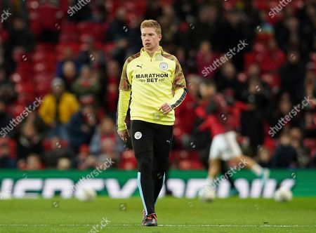 Manchester City's Kevin De Bruyne takes part I the warm up prior to the start of the English League Cup semifinal first leg soccer match between Manchester United and Manchester City and at Old Trafford, Manchester, England