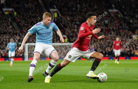 Manchester City's Kevin De Bruyne, left vies for the ball with Manchester United's Daniel James during the English League Cup semifinal first leg soccer match between Manchester United and Manchester City and at Old Trafford, Manchester, England