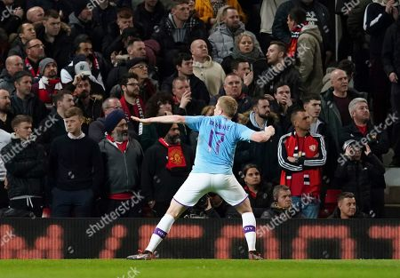 Manchester City's Kevin De Bruyne celebrates after Manchester United's Andreas Pereira was adjudged to have scored an own goal and City's third goal of the game during the English League Cup semifinal first leg soccer match between Manchester United and Manchester City and at Old Trafford, Manchester, England