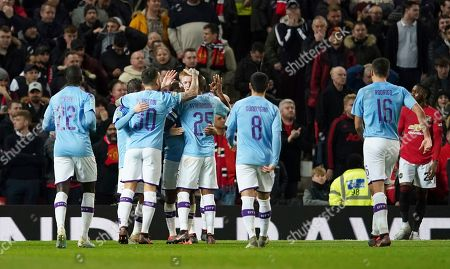 Manchester City's Kevin De Bruyne celebrates with teammates after Manchester United's Andreas Pereira was adjudged to have scored an own goal and City's third goal of the game during the English League Cup semifinal first leg soccer match between Manchester United and Manchester City and at Old Trafford, Manchester, England
