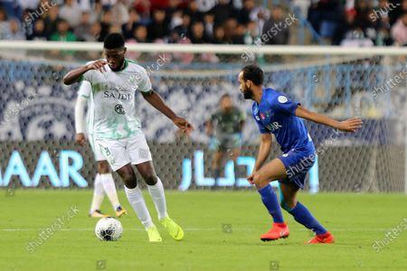 Al-Hilal's Abdullah Otayf (R) in action against AL-Ahly's Djaniny Tavares (L) during the Saudi Professional League soccer match between AL-Ahly and Al-Hilal at King Saud University Stadium, Riyadh, Saudi Arabia, 07 January 2020.