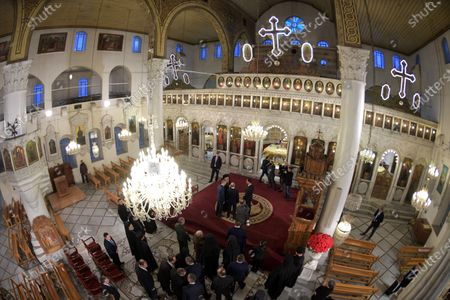 A picture taken with an ultra wide angle lens shows Syrian President Bashar al-Assad and Russian President Vladimir Putin during their visit Cathedral of the Blessed Virgin Mary in Damascus, Syria, 07 January 2020. Putin arrived in Damascus where he met with Assad, visited headquarters of the Russian forces and were briefed by the commander of the Russian forces operating in Syria.