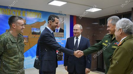Syrian President Bashar al-Assad (2-L), Russian President Vladimir Putin (C) and Russian Defense Minister Sergey Shoygu (2-R) during their meeting at the headquarters of the Russian forces in Damascus, Syria, 07 January 2020. Putin arrived in Damascus where he met with Assad, visited headquarters of the Russian forces and were briefed by the commander of the Russian forces operating in Syria.