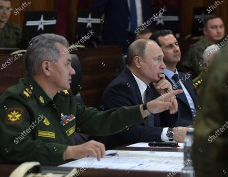 Syrian President Bashar al-Assad (2-R), Russian President Vladimir Putin (C) and Russian Defense Minister Sergey Shoygu (L) during their meeting at the headquarters of the Russian forces in Damascus, Syria, 07 January 2020. Putin arrived in Damascus where he met with Assad, visited headquarters of the Russian forces and were briefed by the commander of the Russian forces operating in Syria.