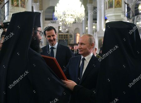 Syrian President Bashar al-Assad (2-L) and Russian counterpart Vladimir Putin (2-R) during their visit Cathedral of the Blessed Virgin Mary in Damascus, Syria, 07 January 2020. Putin arrived in Damascus where he met with Assad, visited headquarters of the Russian forces and was briefed by the commander of the Russian forces operating in Syria.
