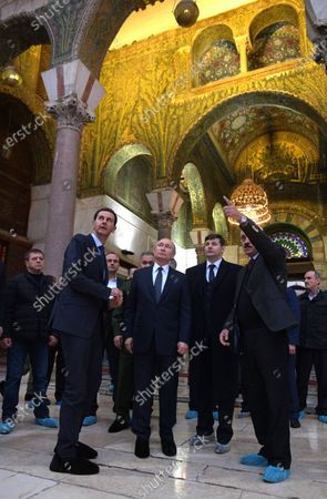 Syrian President Bashar al-Assad (L), Russian President Vladimir Putin (C) during their visit Umayyad Mosque in Damascus, Syria, 07 January 2020. Putin arrived in Damascus where he met with Assad, visited headquarters of the Russian forces and was briefed by the commander of the Russian forces operating in Syria.