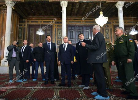 Syrian President Bashar al-Assad (5-L), Russian President Vladimir Putin (C) during their visit Umayyad Mosque in Damascus, Syria, 07 January 2020. Putin arrived in Damascus where he met with Assad, visited headquarters of the Russian forces and was briefed by the commander of the Russian forces operating in Syria.