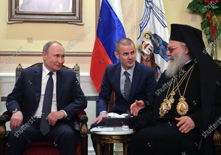 Russian President Vladimir Putin (L) and Greek Orthodox Patriarch of Antioch and All East John X Yazigi (R) and Syrian President Bashar al-Assad during their meeting in Damascus, Syria, 07 January 2020. Putin arrived in Damascus where he met with Assad, visited headquarters of the Russian forces and was briefed by the commander of the Russian forces operating in Syria.