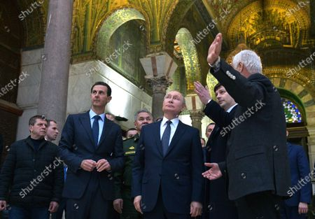 Syrian President Bashar al-Assad (2-L), Russian President Vladimir Putin (C) during their visit Umayyad Mosque in Damascus, Syria, 07 January 2020. Putin arrived in Damascus where he met with Assad, visited headquarters of the Russian forces and was briefed by the commander of the Russian forces operating in Syria.