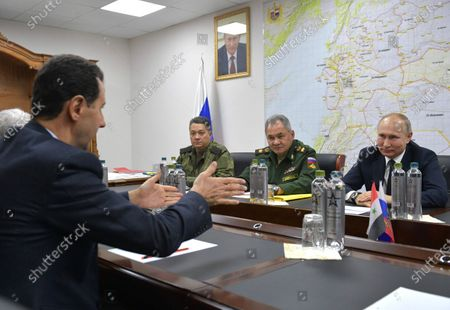 Syrian President Bashar al-Assad (L) and Russian counterpart Vladimir Putin (R) during their meeting at the headquarters of the Russian forces in Damascus, Syria, 07 January 2020. Putin arrived in Damascus where he met with Assad, visited headquarters of the Russian forces and were briefed by the commander of the Russian forces operating in Syria.