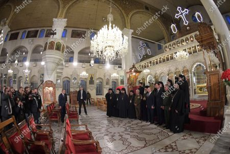 A picture taken with an ultra wide angle lens shows Syrian President Bashar al-Assad (3-R), Russian President Vladimir Putin (7-L), Greek Orthodox Patriarch of Antioch and All East John X Yazigi (R) and Russian Defense Minister Sergey Shoygu (2-R) during their visit Cathedral of the Blessed Virgin Mary in Damascus, Syria, 07 January 2020. Putin arrived in Damascus where he met with Assad, visited headquarters of the Russian forces and were briefed by the commander of the Russian forces operating in Syria.