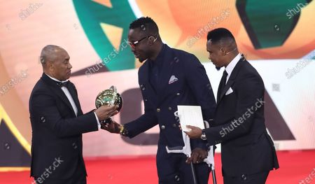 Ahmad Ahmad (L), President of the Confederation of African Football, and Former Cameroonian forward Samuel Eto'o (R) hands over the special award former Togolese footballer Kodjovi Obilale (C) during the Confederation of African Football (CAF) awards ceremony at Albatros Citadel, Sahl Hasheesh, Hurghada, Egypt, 07 January 2020.