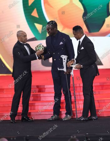 Stock Image of Ahmad Ahmad (L), President of the Confederation of African Football, and Former Cameroonian forward Samuel Eto'o (R) hands over the special award former Togolese footballer Kodjovi Obilale (C) during the Confederation of African Football (CAF) awards ceremony at Albatros Citadel, Sahl Hasheesh, Hurghada, Egypt, 07 January 2020.